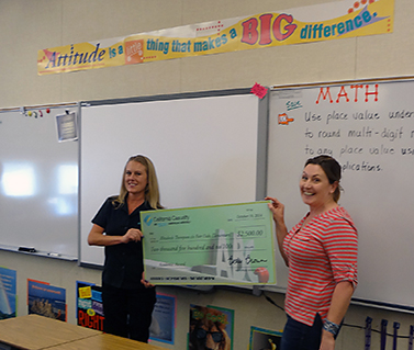 Angie Rajczyk presenting the check to Elizabeth