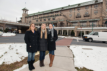 Tracie with her mother and Ashley in front of the Hotel Hershey