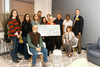 Winner Debbie Seibert celebrates winning the California Casualty School Lounge Makeover